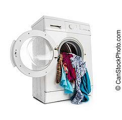 washing machine - Washing machine with clean linen on a...