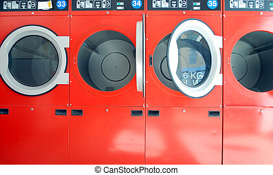 washing machines in a laundrette in a row