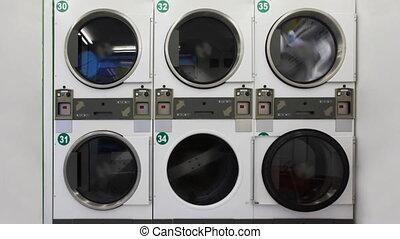 Washing machines in public laundry room - large washing...