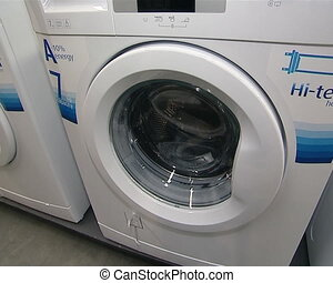 washing machines sold in supermarket shop. latest modern...
