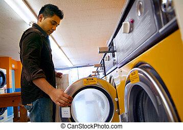 Washing... - Man at a local laundrymat.
