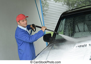 washing the car with detergent