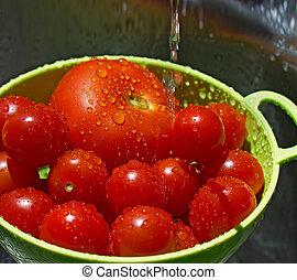 Washing tomatoes.