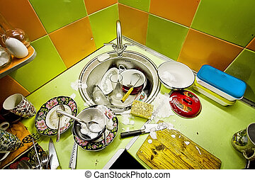 washing-up in kitchen, green and orange tiles on a wall