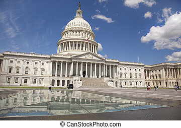WASHINGTON D.C. - MAY 23 2014: The United States Capitol is the meeting place of the United States Congress, the legislature of the U.S. federal government. Located in Washington, D.C., it sits atop Capitol Hill at the eastern end of the National Mall.