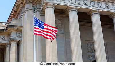 Washington DC Monuments with USA. Flag waving on window