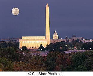 Washington DC skyline at dusk with autumn colorful trees on the foreground