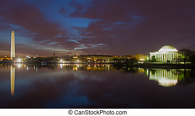 Washington Monument and Jefferson Memorial at night with city skyline. Colorful reflections of Washington landmarks in Tidal Basin.