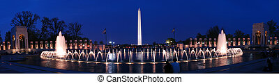 Washington monument panorama and WWII memorial with fountains and light at dusk, Washington DC.