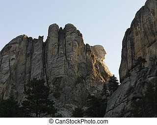 View of George Washington profile on mountain cliffside of Mount Rushmore National Memorial.