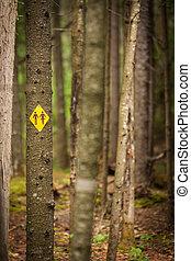 washroom sign in forest