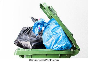 Waste bin top - A close up of a full waste bin top