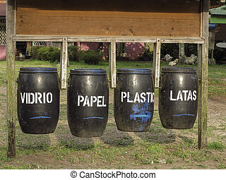 Waste bins for recycling with spanish text