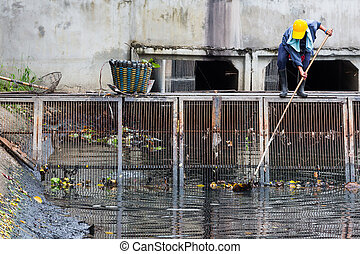Waste cleaning in canal for better flow of water through the...