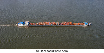 Waste disposal on cargo ship. Boat and scrap metal - Waste...