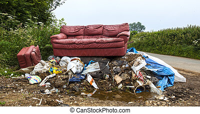 Waste dumped in the countryside, an illegal social issue, fly tipping causing environmental pollution