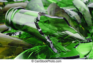 Waste glass. Recicled. Shattered green wine bottle