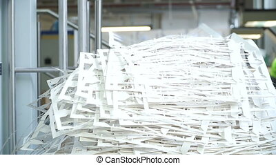 Waste paper in the printing house. Cutting paper after printing