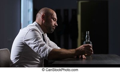 Wasted alcoholic man drinking whiskey at home