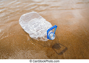 wasted plastic bottle on beach