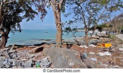 wastes on a beautiful beach