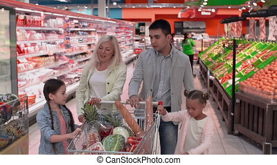Wasting Money - Family enjoying shopping together,...