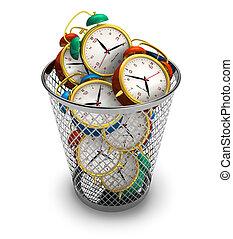 Wasting time concept: alarm clocks in the trash bin