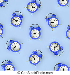 Wasting time concept. Many blue alarm clock