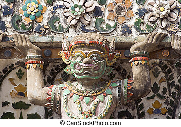 Wat Arun Demon - Detail of demon guardian sculpture at the...
