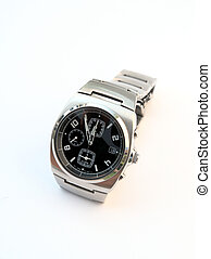 Watch - A metallic watch with black clock face on white ...