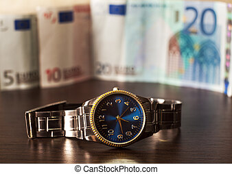 watch against the background of banknotes