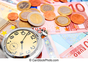 Watch and coins on the euro banknotes.