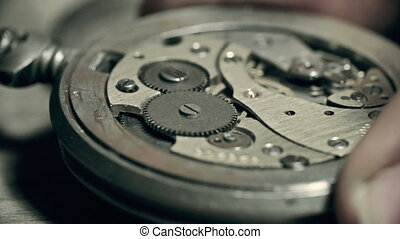 Watch Mechanics - Unrecognizable master fixing watch
