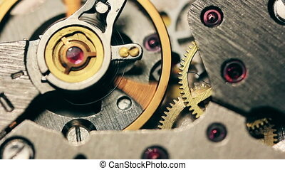 Watch mechanism macro loop. Old vintage clock mechanism working, closeup shot with soft focus. Close up of a internal clock mechanism. Vintage Watch Gears Movement Macro