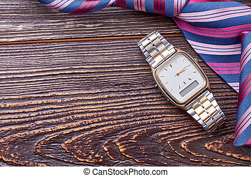 Watch on wooden background.