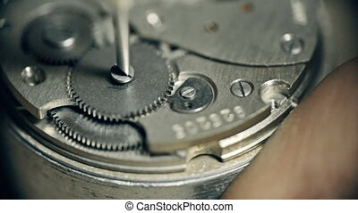 Watch Wheel - Extreme close up of watch wheel unscrewed and...