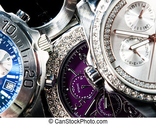 Watches - Macro view of many wrist watches.