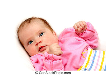 watchful newborn baby girl on pillow close-up