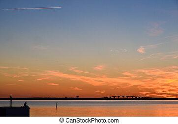 Watching bridge at sunset