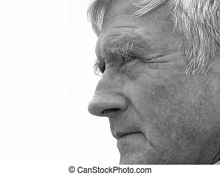Watching - Elderly man carefully watching something