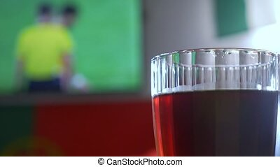 Watching football game on television at local pub. Food,...