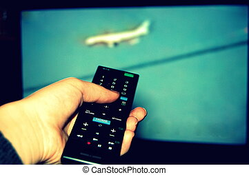 watching television, zapping with the remote control