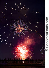 Watching the Fireworks - Silhouetted people watching a ...