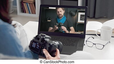 Woman watching photo camera review, remote home learning, photography tutorial profit