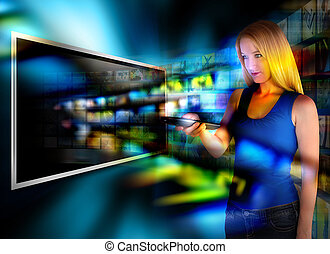 Watching Video TV with Remote Control - A person is holding...