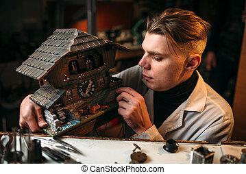 Watchmaker restore old wall clock