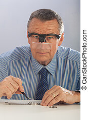 Watchmaker With Glasses