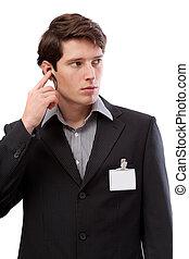 Watchman with earplug and empty id card