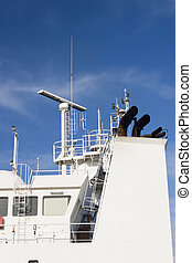 Watchtower, antennas, radar and other communication and navigation equipment on the command bridge of a ship.