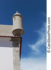 Watchtower of the fortress on the beach in Sesimbra village